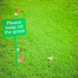 Retro look Keep off the grass sign — Stock Photo #44536171