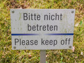 Please keep off from the grass sign — Stock Photo