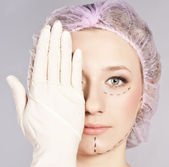 Lines on lady face, as marks for cosmetic plastic surgery — Stock Photo