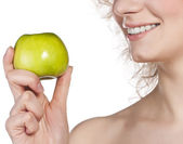 Healthy teeth and green apple. Studio shoot — Stock Photo