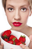 Sexy blonde with strawberry — Stock Photo