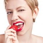 Sexy blonde eats strawberries — Stock Photo