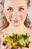 Happy, healthy woman with salad — Stock Photo