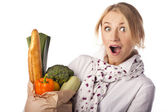Beautiful woman and basket with vegetables — Stock Photo