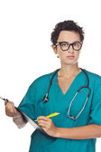 Young doctor writes a diagnosis. Studio — Stock Photo