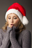 Christmas woman in sweater isolated on black — Stock Photo