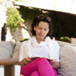 Woman reading a a fascinating book outdoor — Stock Photo #16022939
