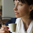 Closeup of a cute woman looking away with cup coffe — Stock Photo #16022941