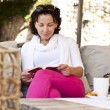 Positive young woman reading a book — Stock Photo