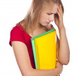 Stock Photo: Despondent student in studio. White