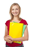 Female student holding notebooks — Stock Photo