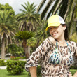 Stock Photo: Attractive woman in a cap on vacation