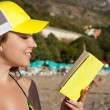 Stock Photo: Outdoor picture of lovely teenage girl with book