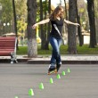 Woman rollerblading in the park in spring — Stock Photo