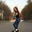 Attractive student rollerblading in summer — Stock Photo