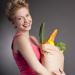 Beautiful woman with fruits and vegetables — Stock Photo #18283063