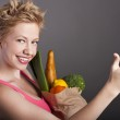 Beautiful woman with fruits and vegetables — Stock Photo