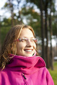 Positive girl in a park. eyes. glasses — Stock Photo