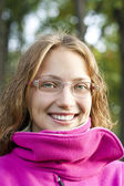 Young student. Smiling, wearing glasses — Stock Photo