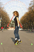 Young girl roller skates in the park — Stock Photo