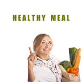 Positive woman with a vegetarian meal. Vegetarians — Stock Photo