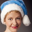 Portrait of beautiful woman in santa hat. isolated on white — Stock Photo #23467026