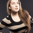 Female against a dark background. striped jacket — Stock Photo