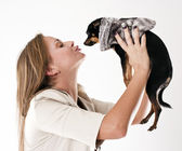 Portrait of young glamorous woman with little dog — Stock Photo