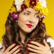 Beautiful spring girl wearing flowers hat — Stock Photo
