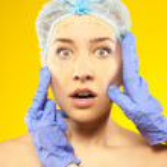 Plastic surgery. Isolated on yellow — Stock Photo #24567323