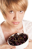 Blonde with cherries. studio white background — Stock Photo