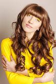 Gorgeous brunette hair. hair cosmetics — Stock Photo