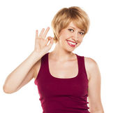 Lovely woman showing ok sign — Stock Photo
