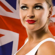 Stock Photo: Young woman on the background with british national flag