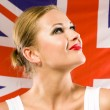 Stock Photo: British womholding Jack Union flag