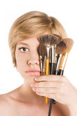 Beautiful woman using a make-up brush, isolated on white — Stock Photo