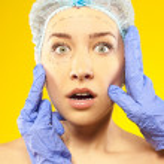 Plastic surgery. Isolated on yellow — Stock Photo #33400765
