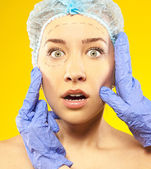 Plastic surgery. Isolated on yellow — Stock Photo