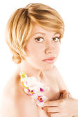 Beautiful woman cares for the skin — Stock Photo
