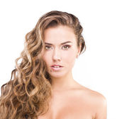 Brown curly hair. Fashion model over white background — Stockfoto