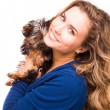 Cute young girl holding Yorkshire terrier dogs — Stock Photo