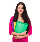 Cheerful young student with exercise books isolated on white background. — Stock Photo