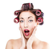 Shoked girl with curlers — Stockfoto