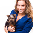 Young woman holding Yorkshire terrier dog — Stock Photo #38664521