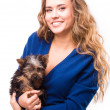 Young woman holding Yorkshire terrier dog — Stock Photo #38664541