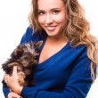 Young woman holding Yorkshire terrier dog — Stock Photo #38664545