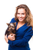 Young woman holding Yorkshire terrier dog — Stock Photo