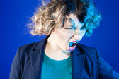 Dissatisfied woman yells. — Stock Photo