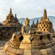 Buddha statue inside one of Borobudur temple stupas — Foto de Stock