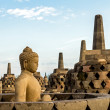 Buddha statue inside one of Borobudur temple stupas — Stock Photo